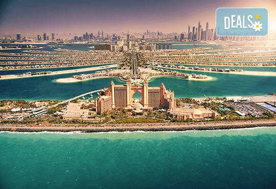 Екзотика през 2020г. в Дубай! 4 нощувки със закуски и вечери, самолетен билет, трансфери, посещение на Абу Даби и сафари в пустинята - Снимка 1