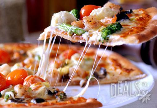 За всички почитатели на италианската кухня! Вечеря или обяд за двама: 2 пици Капричоза само за 9.90лв вместо 17лв в Ресторант Бадемова къща - Панчарево!