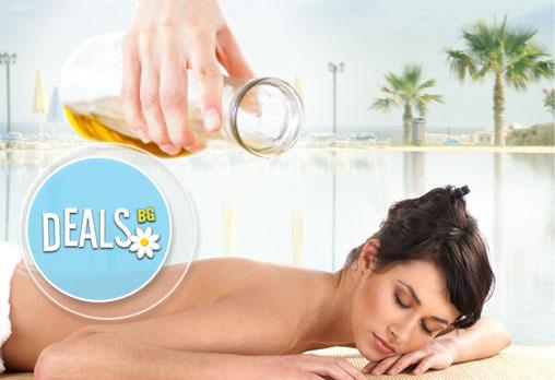60 мин. болкоуспокояващ масаж с натурални био масла + рефлексотерапия в Студио Матрикс 77